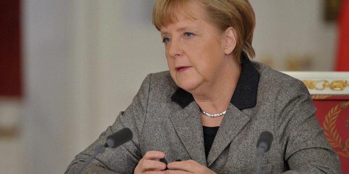 Меркель освистали за Украину
