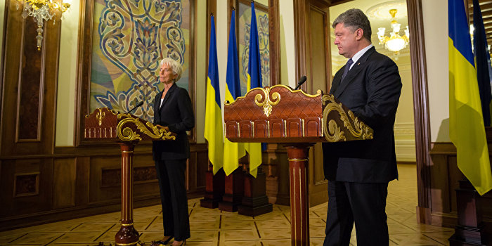 МВФ: Пусть Киев платит свой долг России сам