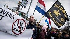 Акции против мигрантов и исламизации прошли в Европе