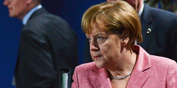 Меркель заявила о стремлении снять санкции с России