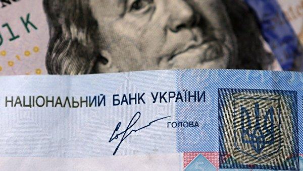 Оправдание от НБУ: Девальвация гривны не связана с национализацией «Приватбанка»