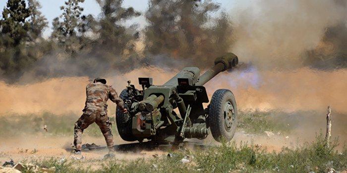 Источник: боевики ИГИЛ атаковали сирийских военных одновременно с США