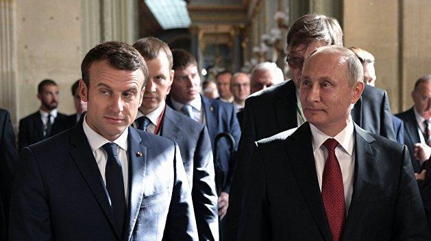 Путин и Макрон договорились о совместных усилиях по деэскалации конфликта в Сирии