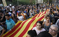 «КоммерсантЪ»: Каталонии надевают испанский сапог