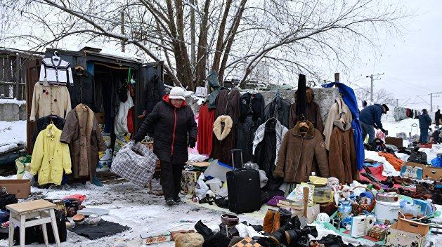 Бой с тенью. На Украине «кошмарят» торговцев блошиных рынков и вводят налоговое стукачество