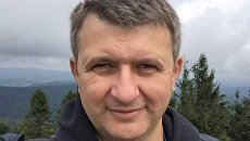 Романенко: Порошенко стал митрополитом, а не президентом