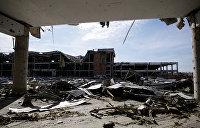 Темная башня войны в Донбассе. Что скрывается за историей обороны аэропорта в Донецке