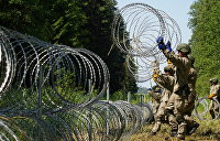 Мигранты, стена и немножко концлагеря. Политические тучи над границей Белоруссии и ЕС